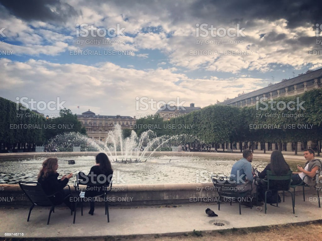 Jardin du Palais-Royal: people relaxing in Paris, France stock photo