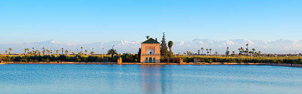 jardins menara and atlas mountains, marrakech panorama - north africa stock photos and pictures