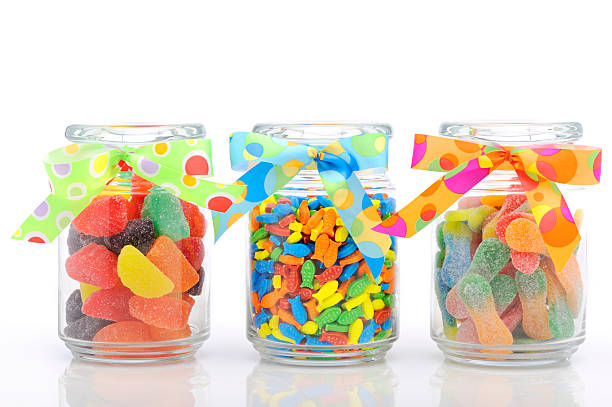 Jars filled with colorful candy Colorful jars of candies. studio shot. jujube candy stock pictures, royalty-free photos & images
