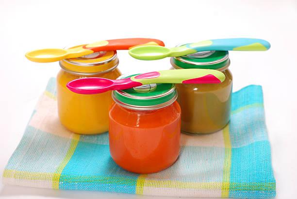 jars of baby food stock photo