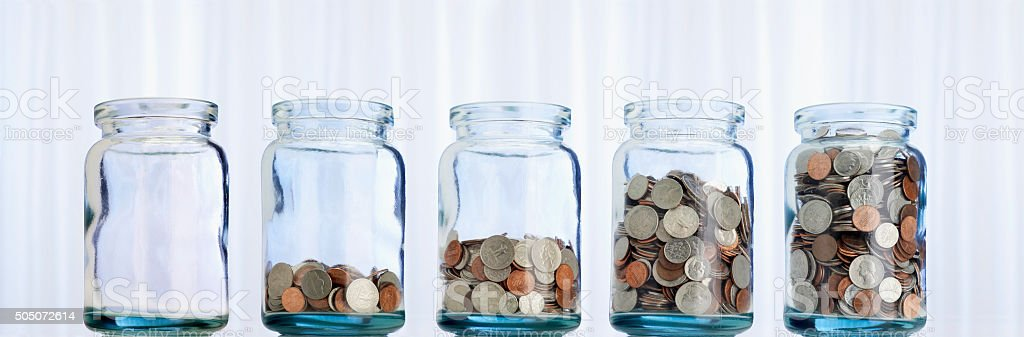 Jars of coins stock photo
