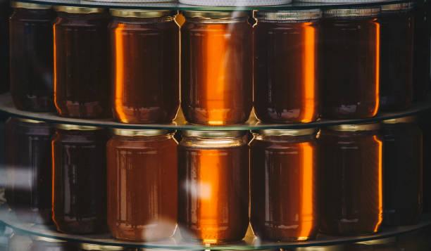 jars of honey as delicious nutrient ingredient stock photo