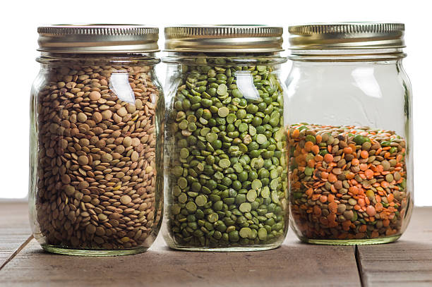 jars of lentils on a counter stock photo