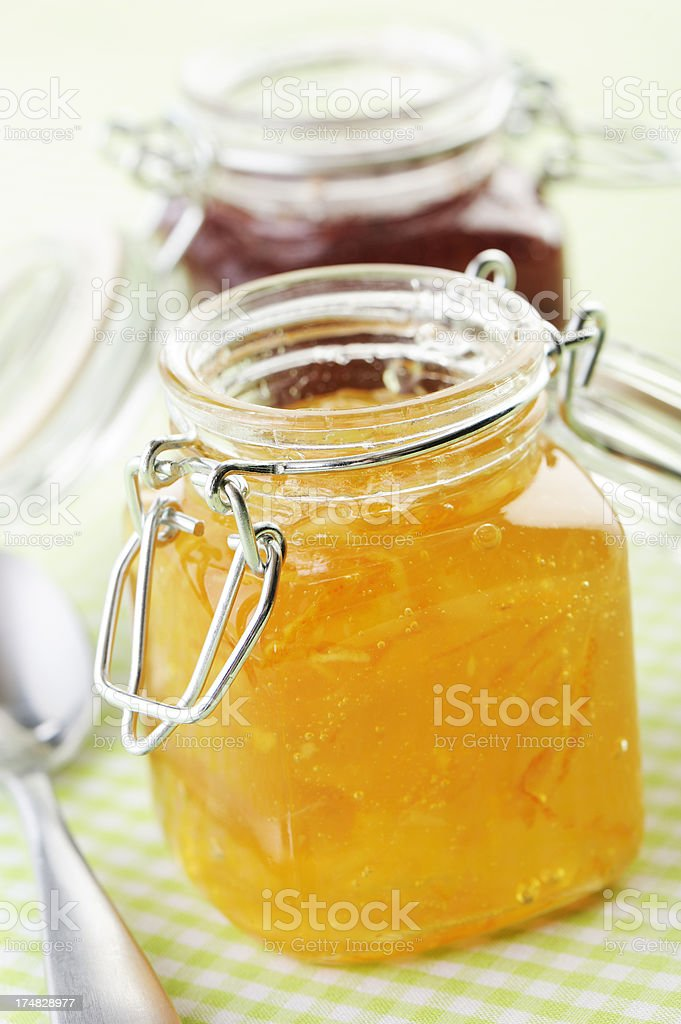 Jars of marmalade and red berry jam royalty-free stock photo