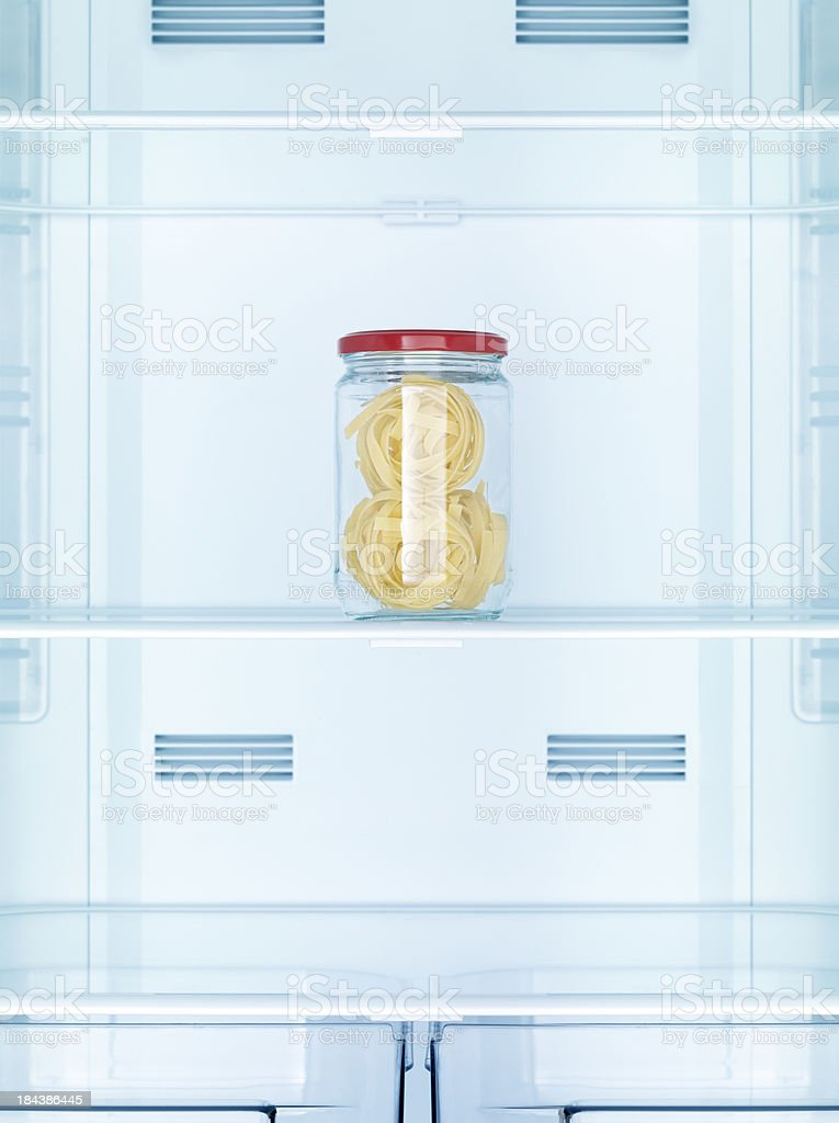 Jars of pasta in the refrigerator royalty-free stock photo