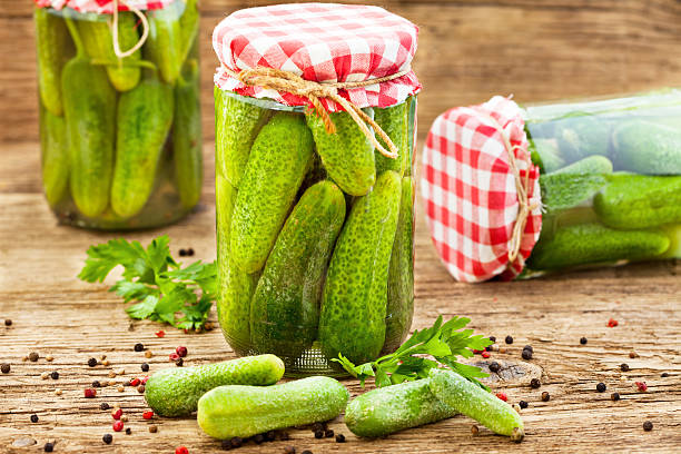 Jars of pickled marinated cucumbers stock photo