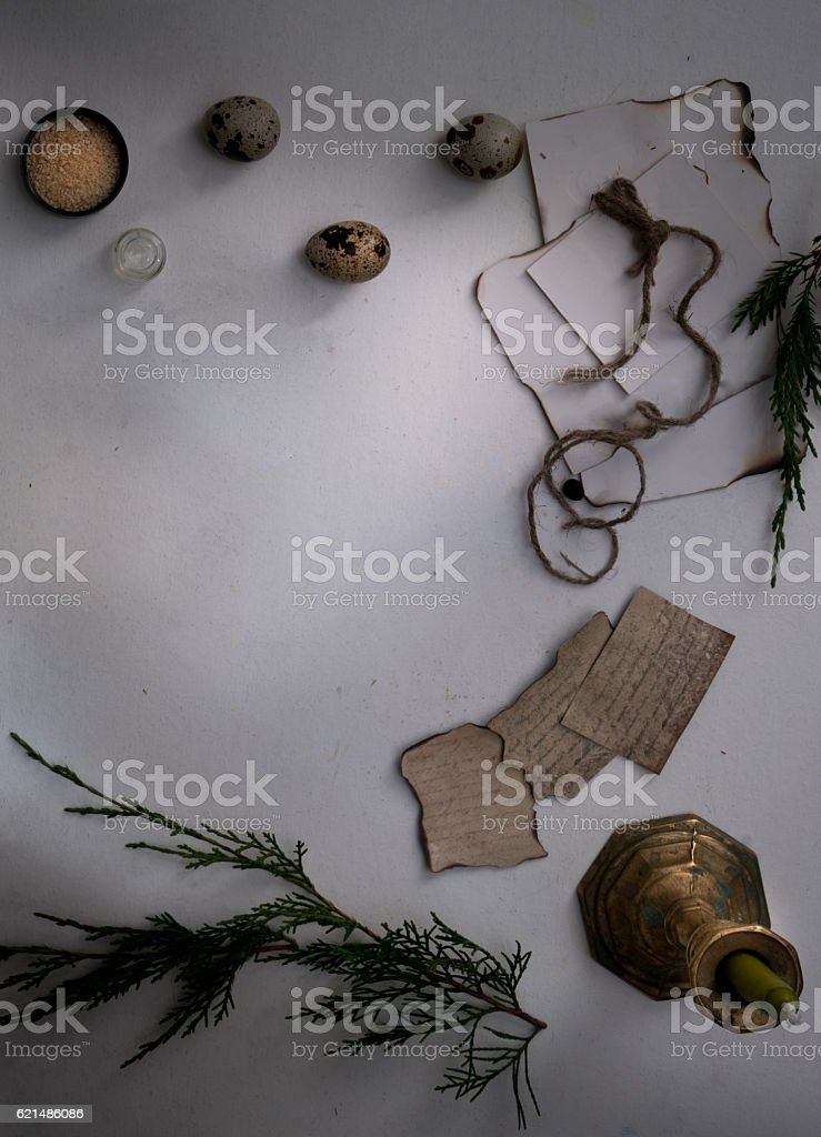 jars of powders, leaves burnt paper, candle, quail eggs on Lizenzfreies stock-foto