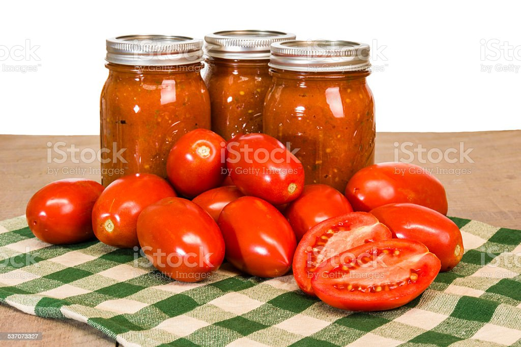 Jars of tomato sauce with paste tomatoes stock photo