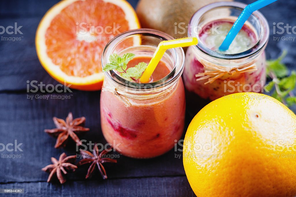 Jars with smoothies and fruits royalty-free stock photo