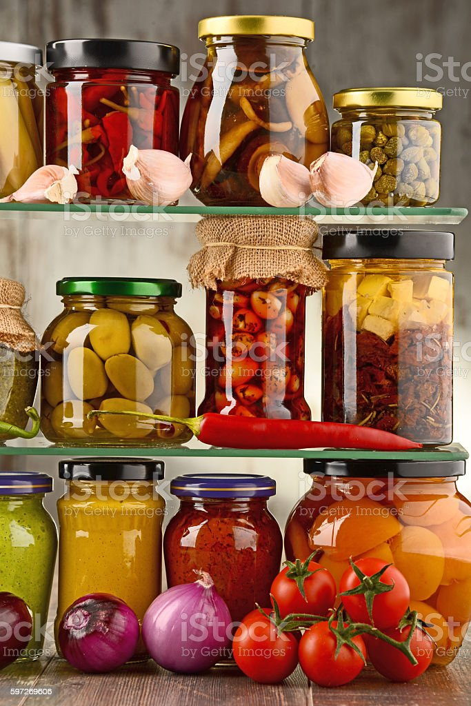 Jars with variety of pickled vegetables. royalty-free stock photo
