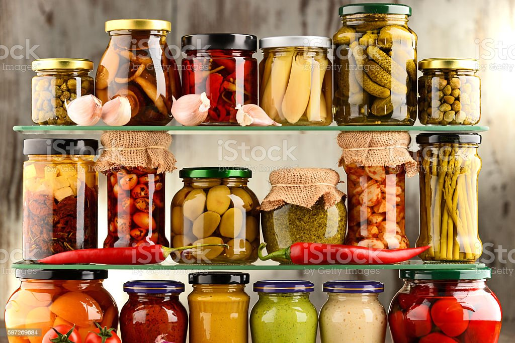 Jars with variety of pickled vegetables. Lizenzfreies stock-foto