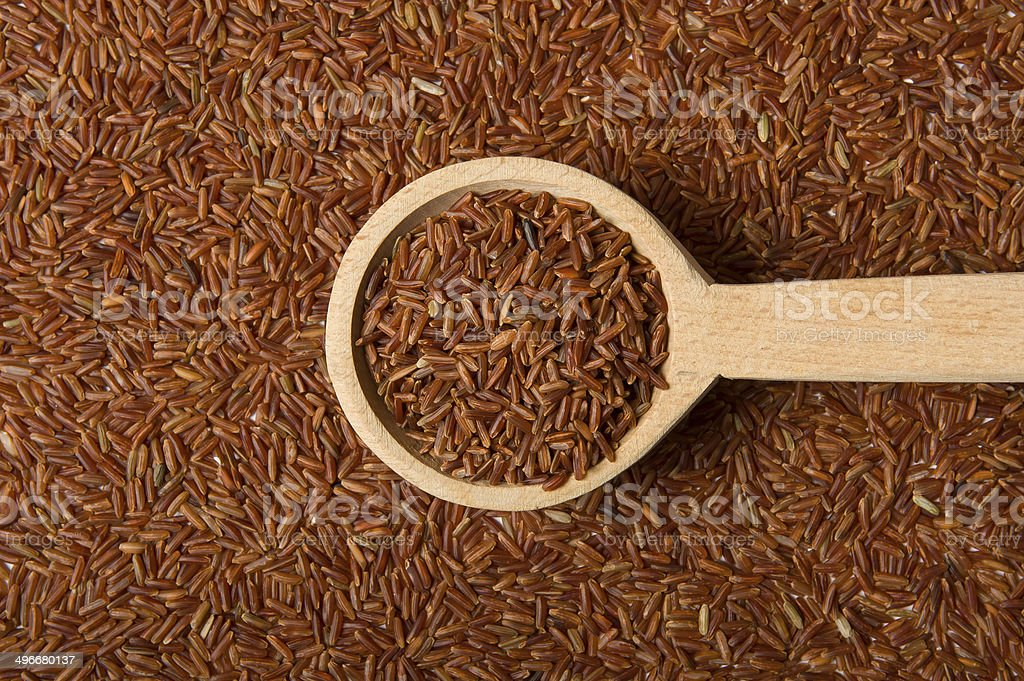 Jasmine Brown Rice on a wooden spoon royalty-free stock photo