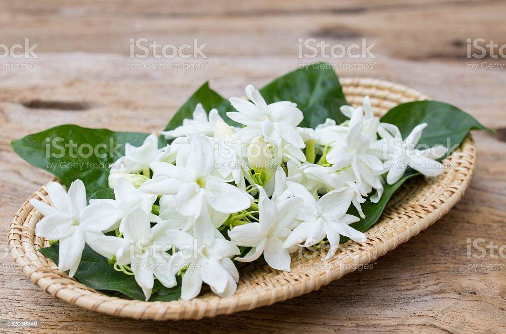 Jasmine flowers in basket ,soft focus stock photo