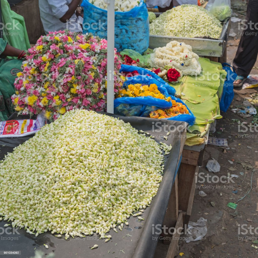 Jasmine flowers on sale for hair decoration in india stock photo jasmine flowers on sale for hair decoration in india royalty free stock photo izmirmasajfo