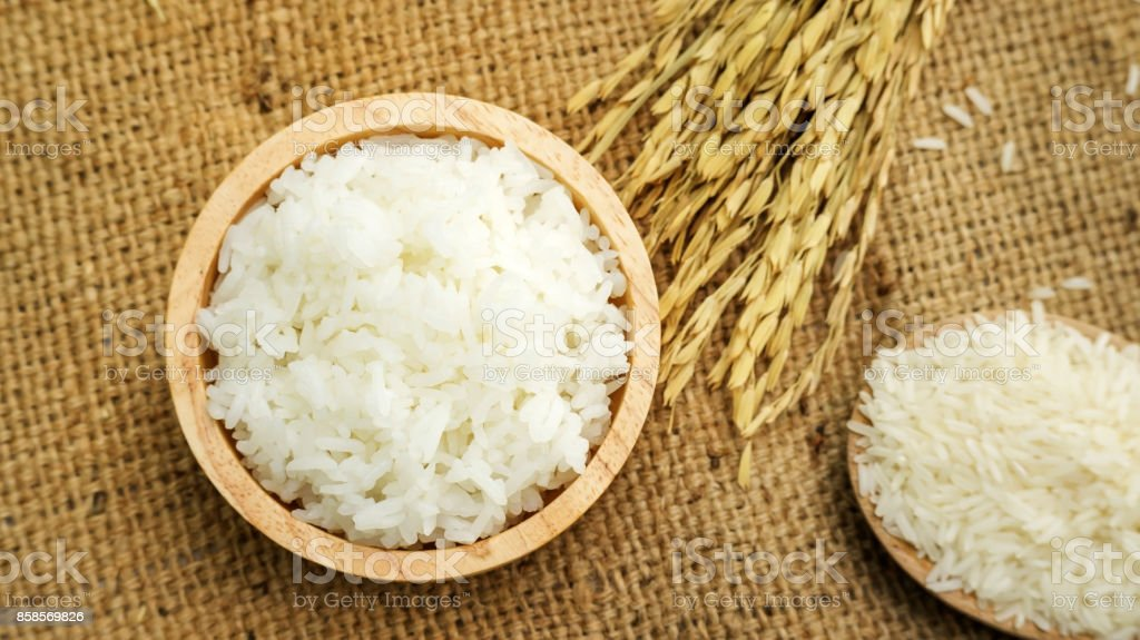 Jasmine rice in a bowl on a wooden table. stock photo