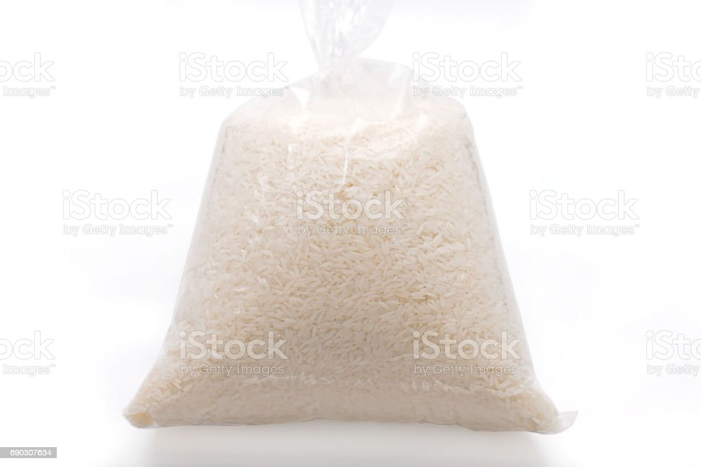 Jasmine Rice in Plastic Clear Bag on White Background stock photo