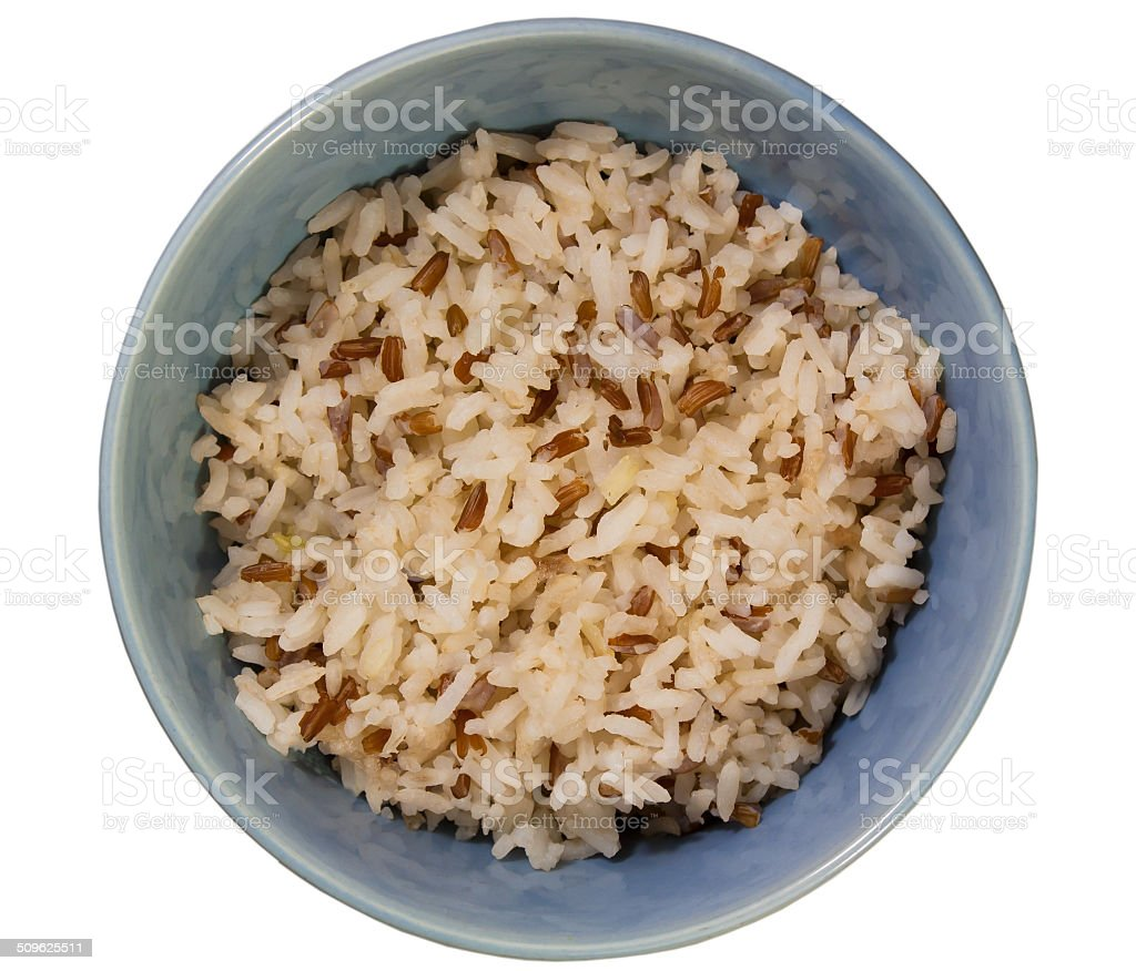Jasmine Rice with brown rice in a dish on a white background. stock photo