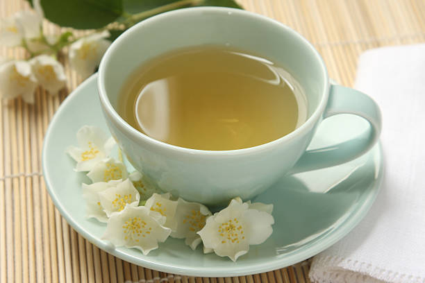 Jasmine tea and flowers stock photo