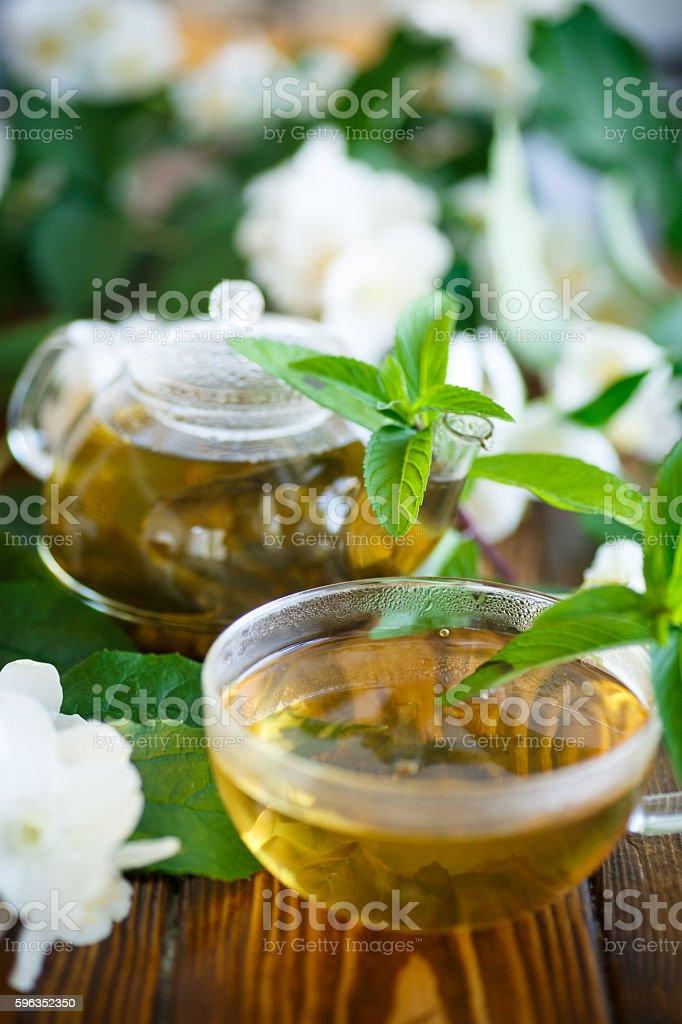Jasmine tea in a glass pot royalty-free stock photo
