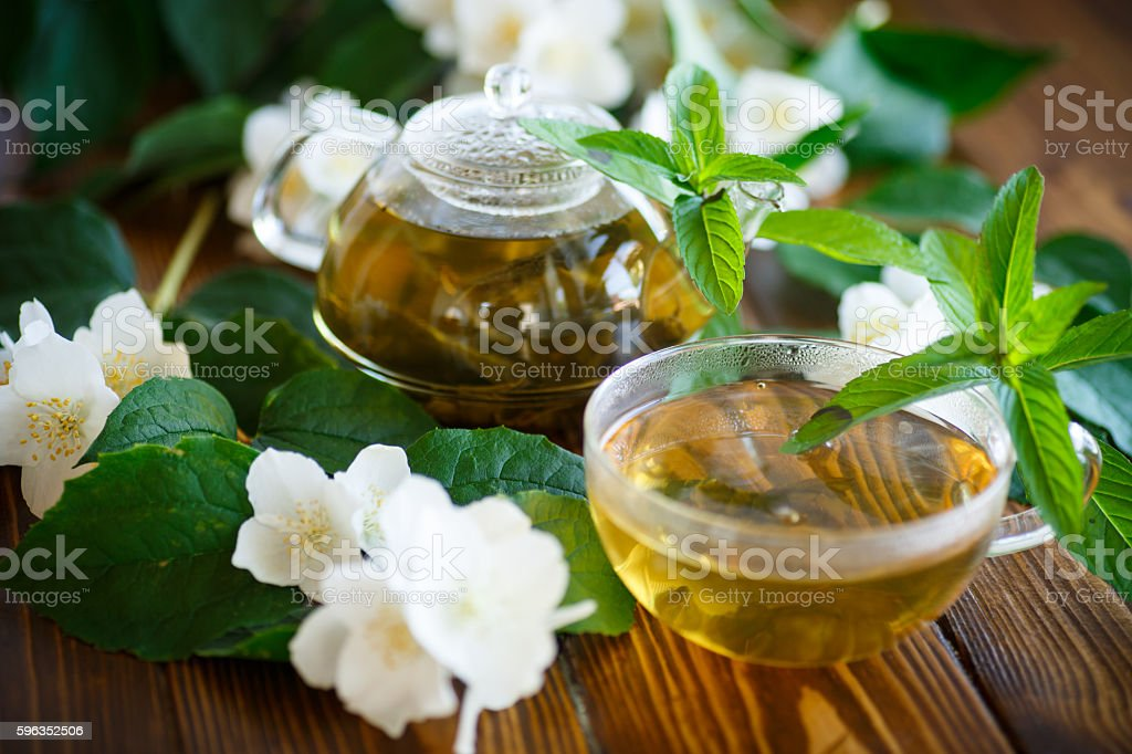 Jasmine tea in a glass pot royalty-free stock photo