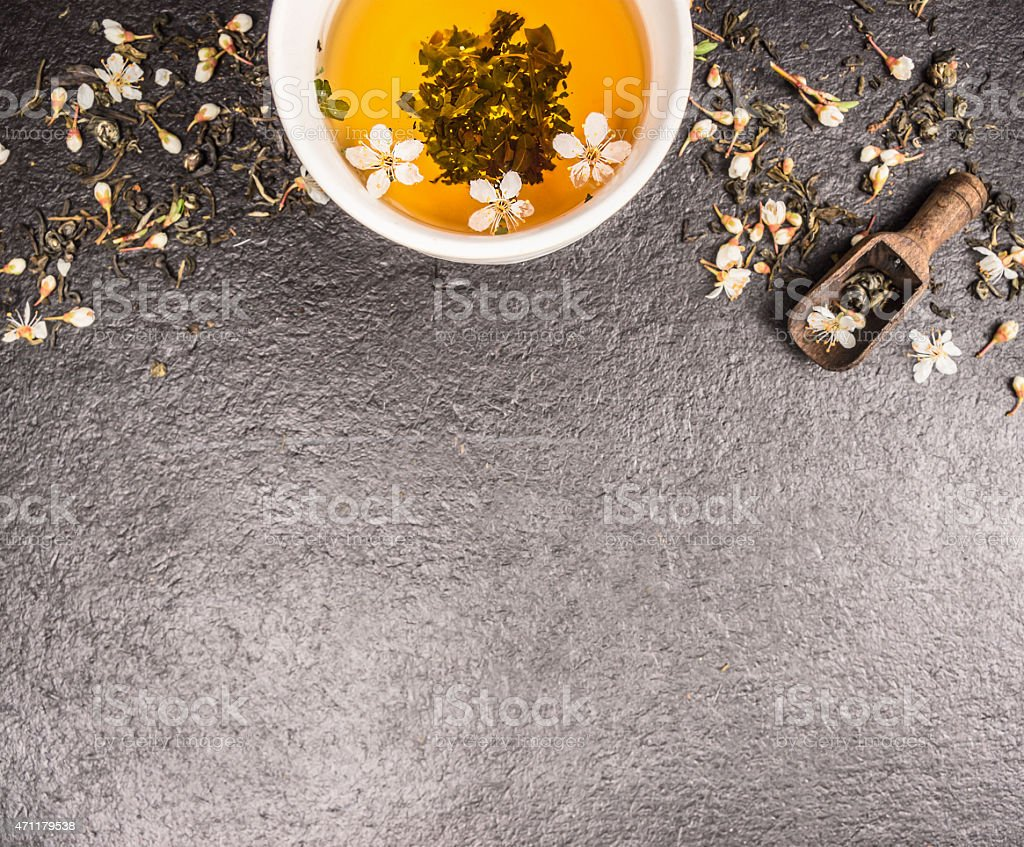 Jasmine tea on stone background with fresh flowers and cup stock photo