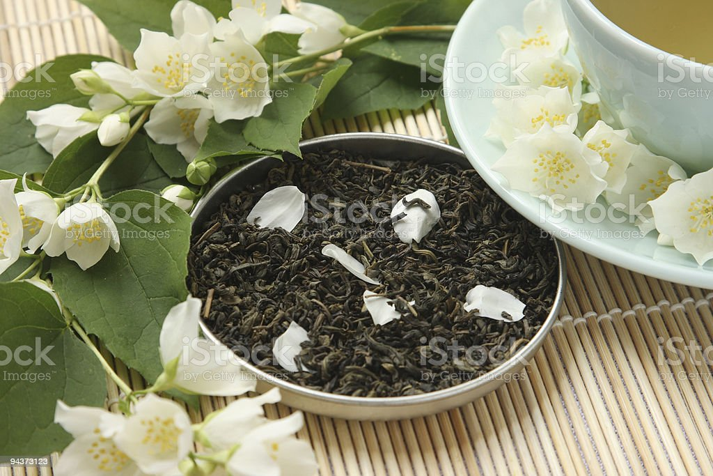 Jasmine tea with petals royalty-free stock photo