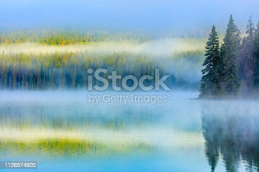 Pyramid Lake with fog in Jasper National Park