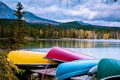 Jasper town Canada, lakeshore with colorful kayak, sunrise by the lake at Jasper , Lac Beauvert Alberta Canadian Rockies Canada lake