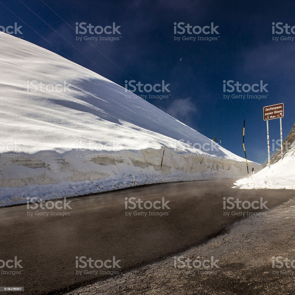 Jaufenpass highest point with blue sky and mist stock photo