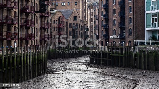 London, United Kingdom - January 27, 2007: Java wharf dried when river Thames is low. This usually nice riverside location looks sullen without water.