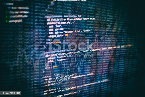 Website HTML Code on the Laptop Display Closeup Photo. Desktop PC monitor photo.