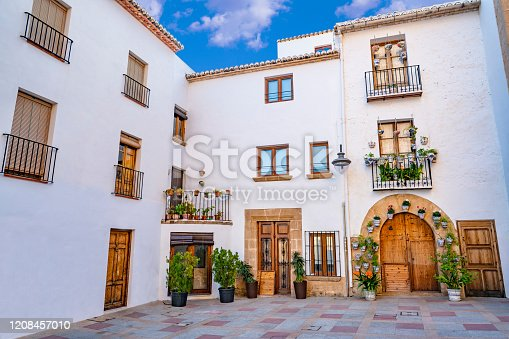 Javea Xabia spanish white Mediterranean facades with flower pots in Alicante of Spain
