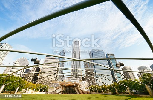 Chicago, Illinois, USA - August/26/2012: Jay Pritzker Pavilion in Millennium Park in Chicago. It is the home of the Grant Park Symphony Orchestra and Chorus, and the Grant Park Music Festival. Downtown Chicago skyscrapers in the background.