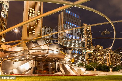 The Jay Pritzker Pavillion, a bandshell designed by Frank Gehry, illuminated at night. It is a beautiful centerpiece of Millenium Park, located in downtown Chicago, hosting a wide range of music performances and performing arts events.