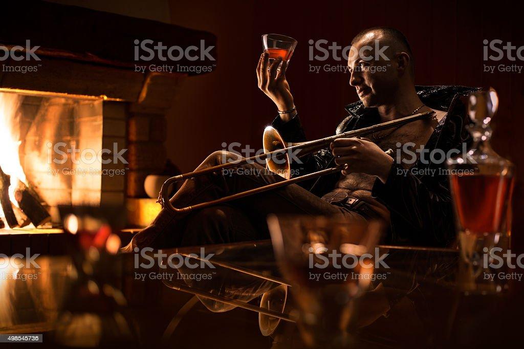 Jazz man is degustating  expansive cognaq stock photo