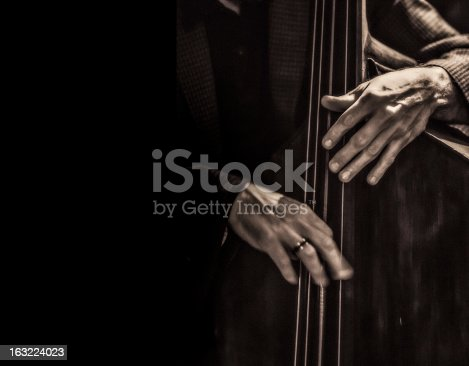Jazz musician playing the double bass.