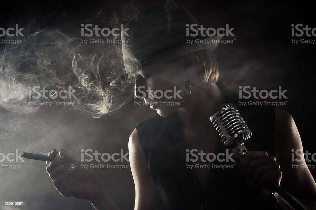 jazz singer with cigar and microphone stock photo