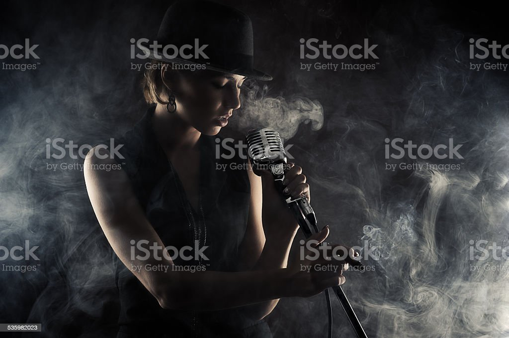 jazz singer woman with retro microphone stock photo