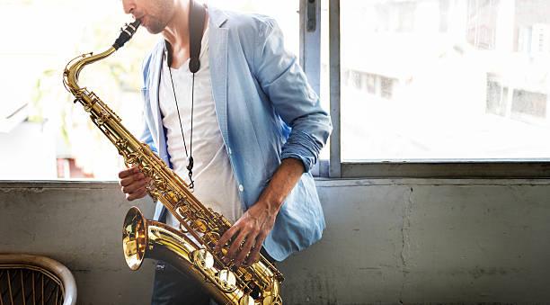 jazzman musical artist playing saxophone concept - altsaxophon stock-fotos und bilder