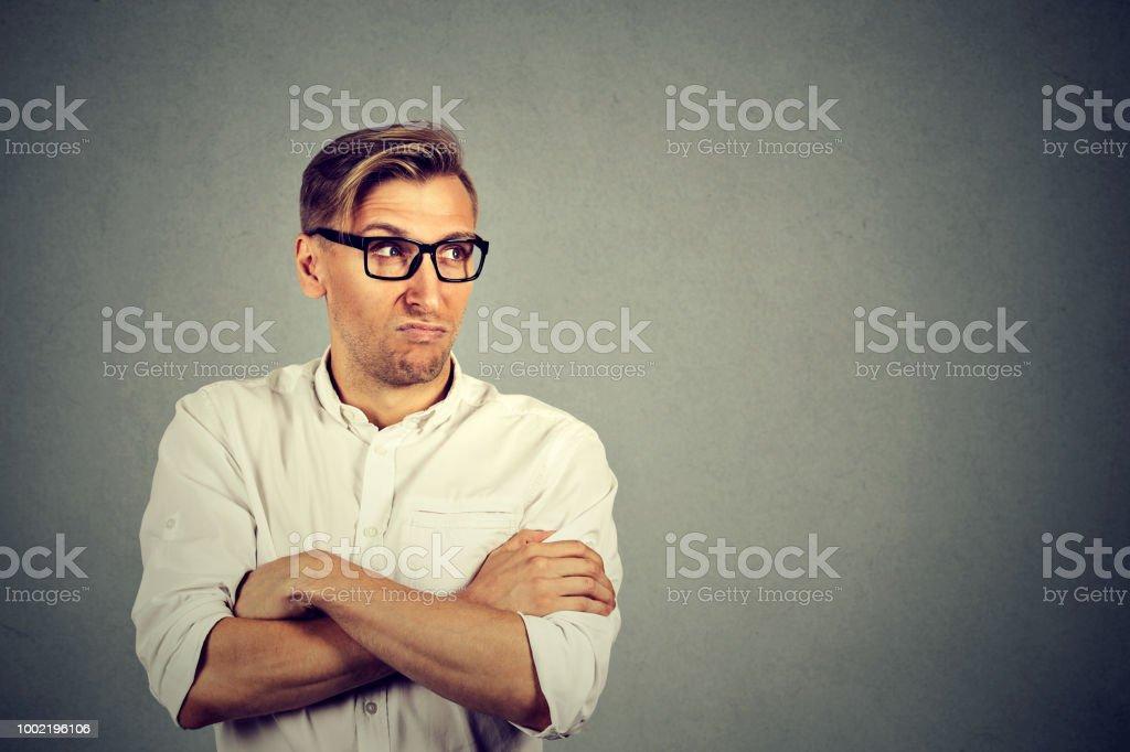 Jealous man looking away in dislike stock photo