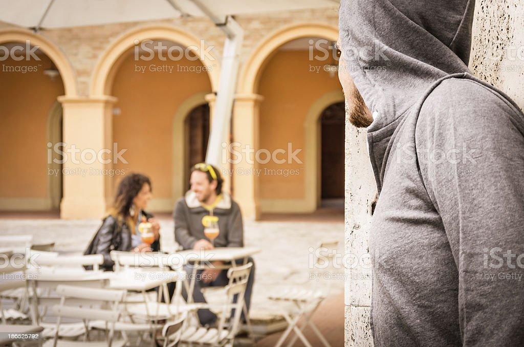 Jealous Man stalking couple of Lovers stock photo