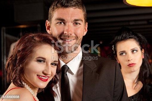 istock Jealous Woman In Background Of Couple's Photo 513393938