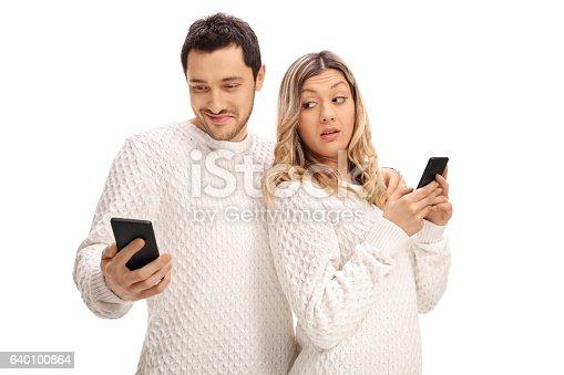 494388938istockphoto Jealous woman looking at her boyfriends phone 640100864