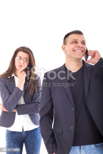 istock jealous woman looking at her man chatting on the phone 481511683