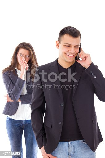 istock Jealous woman looking at her partner chatting on the phone 472218853
