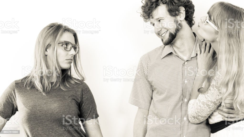 Jealous woman with happy couple royalty-free stock photo
