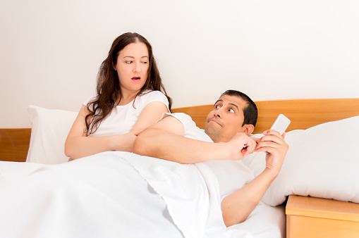 jealous woman with her husband