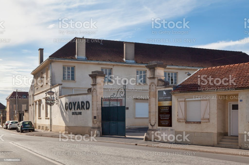 "Jean Goyard Distillery in A Aÿ, France - July 23 2020: The Jean Goyard Distillery was founded in 1911 and in 1927, a team of distillers traveled through Champagne with twelve stills to transformed the ""waste"" of the harvest into powerful eaux-de-vie and ratafia. Nowadays, the distillery is best known for producing four types of alcohol: La Fine de la Marne; Ratafia; Marc de Champagne and champagne. Alcohol - Drink Stock Photo"