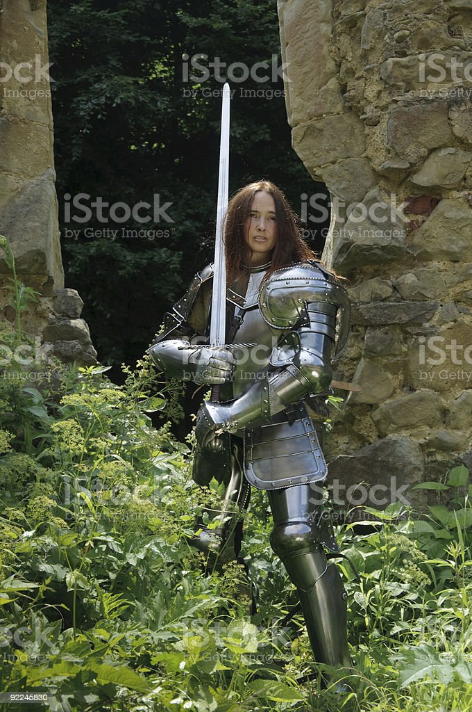 Jeanne D'Arc standing with raised sword stock photo