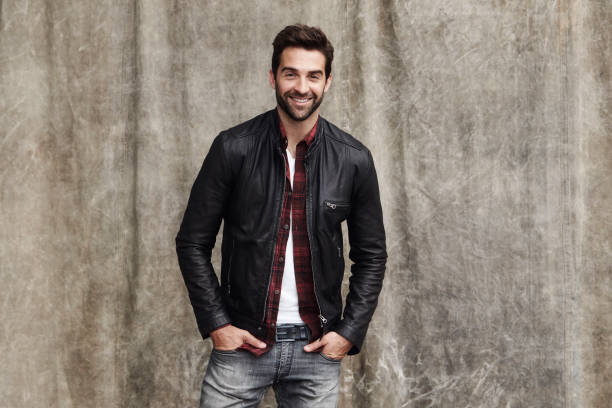Jeans and jacket Jeans and jacket guy in studio, smiling leather jacket stock pictures, royalty-free photos & images